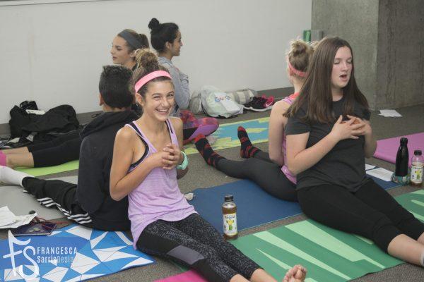 Teen participants on yoga mats
