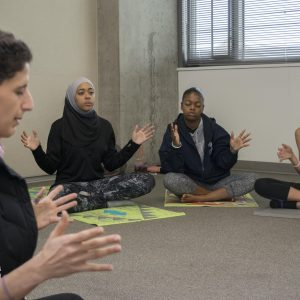 Teen participants meditate