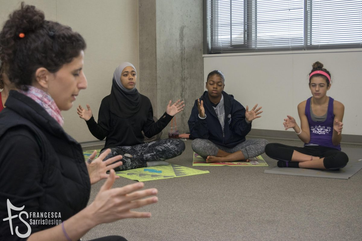 Teen participants meditate