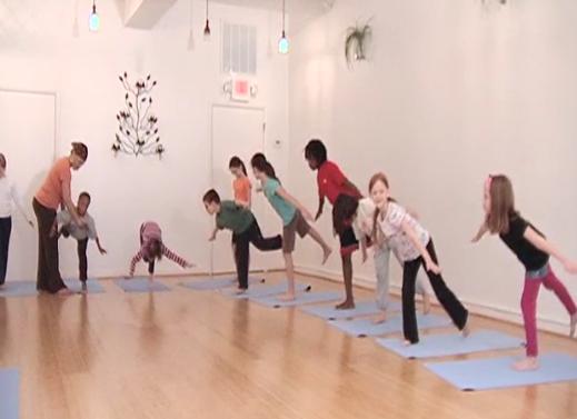 YoKid students practice Warrior 3