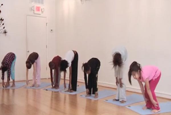 YoKid students practice forward bend
