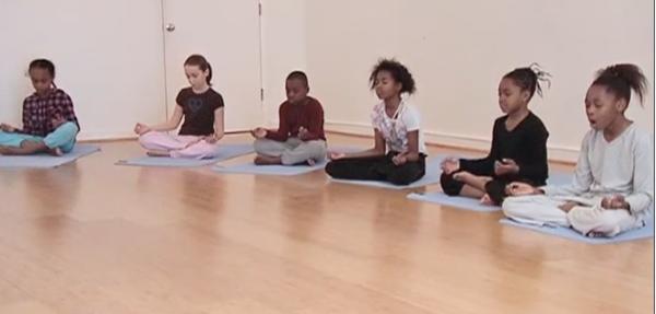 YoKid students practice easy pose